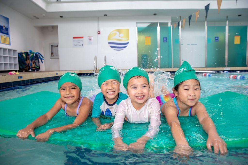 Kid swimmer holding onto lane divider