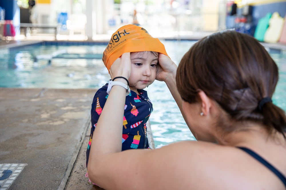 child in Swim Class