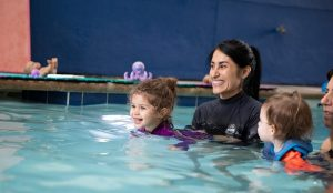 Toddler with swim instructor