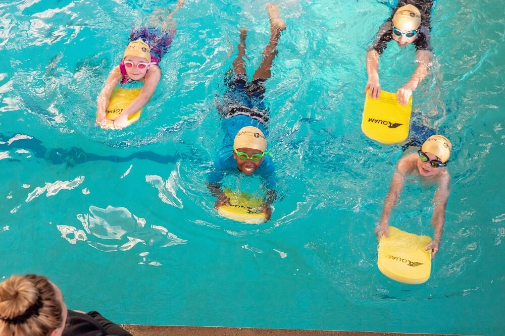 Group of kids with kickboards