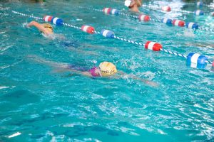 Children swimming laps